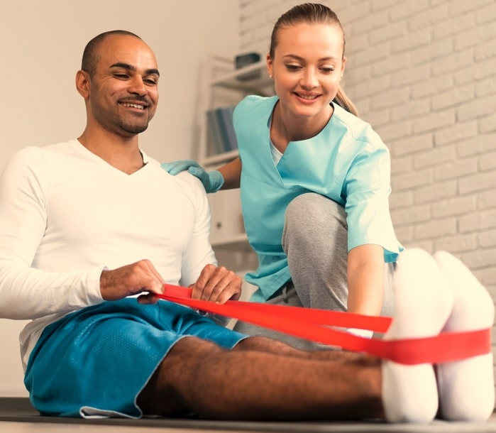 physical therapist doing Physical Therapy with a patient