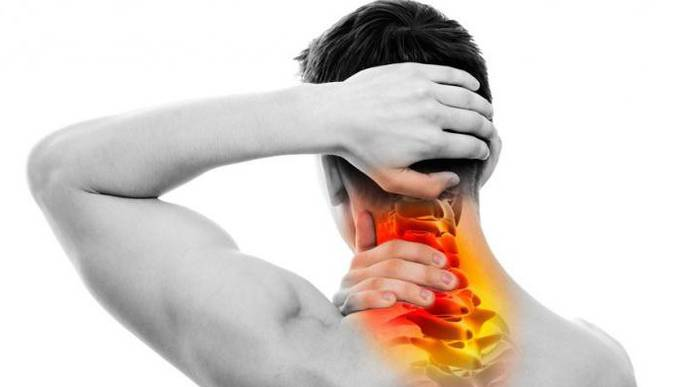 Man needing chiropractic neck pain treatment in the Woodlands.