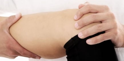 Chiropractor treating a patient with knee pain